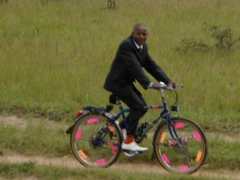 Dressed to impress! A boy in a suit beats us riding his bike in his Sunday best