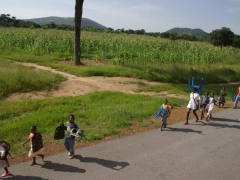 School kids carrying their own chairs to school...the efforts Angolan kids go through to get an education is amazing