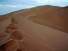 Hiking up the sand dunes of Erg Admer