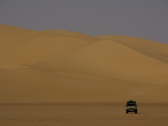 Our 4x4 approaching to give us a ride; Erg Admer sand dunes