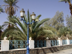 Blue lightposts line the main street in Djanet