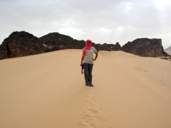 Becky on a sand dune on our hike from Tikobawhen to Tilalen