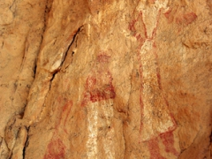 Our guide pointed out the white clothing worn by the figurines of this cave painting; Emouroden