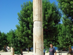 Becky next to a roman column in the main park of Cherchell