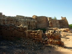 Ruins of hillside buildings built into the existing stone outcroppings; Tipaza