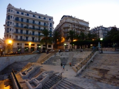Children playing football after sunset on empty steps in the center of Algiers