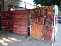 Carpets for sale near the main entrance of Tipaza's Roman ruins