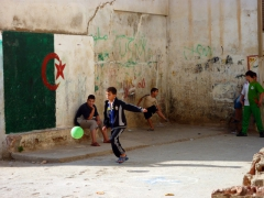 Boys playing football in the Casbah; Algiers