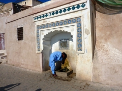 Our guide (Salim) drinks from a fountain in the Casbah near Sidi Ramdane Mosque; Algiers