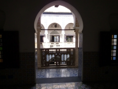 View of the Palais Des Rais courtyard through an arched doorway; Algiers