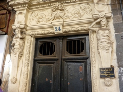 Statues grace the doorways of many buildings throughout Algiers