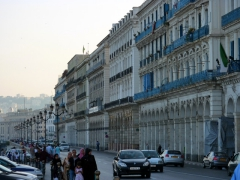 Typical white-washed buildings with blue shutters that are so popular in Algiers