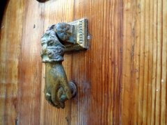 Unique knocker on a wooden door; Casbah, Algiers