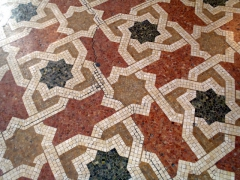 Decorative geometric designs of the floor mosaic in the Grande Poste; Algiers