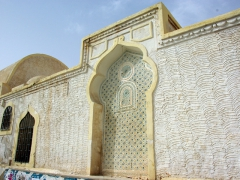 A mihrab looking niche in a wall on a building in El Oued