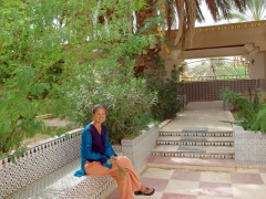 Becky sitting in the courtyard of Hotel Du Souf; El Oued