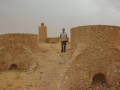 Becky standing near an abandoned mosque
