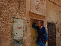Becky perched outside a dwelling in Melika