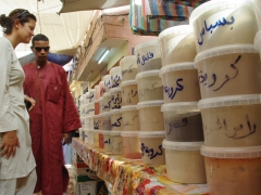 Salim shows Becky dozens of spices for sale; Ghardaia market