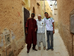 Different clothes of Algeria (Salim in traditional Tuareg garb, our El Atteuf guide in traditional M'zab valley pants, and Fouad in western clothes)
