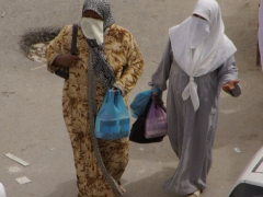 Two married ladies (as indicated by the face covering) walking the streets of El Oued