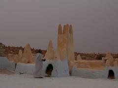 Local praying at the tomb of Sidi Aissa; Melika