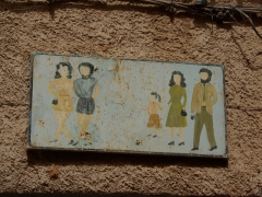 Ghardaia signpost indicating inappropriate and appropriate clothing for tourists