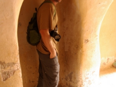 Robby in a niche where married women of El Atteuf used to have to squeeze into (facing towards the wall) when they pass by men, lest a men should glimpse at their solitary eyeball