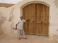 Our El Atteuf guide at the entrance to Sheikh Sidi Brahim Mosque