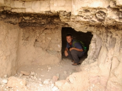 Robby crouching down in the ruins of El Golea's old ksar