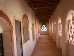 Hallway leading to rooms at the now defunct Hotel de l'Oasis Rouge; Timimoun