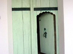Old fashioned door (a smaller doorway exists within the larger door frame); Guemar zaioua
