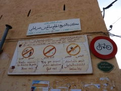 Sign welcomes visitors to Beni Isguen, but reminds that photos of inhabitants is forbidden and to dress conservative