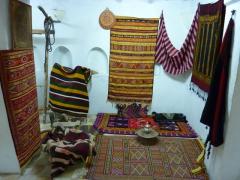 Kilim rugs adorn the interior of a typical mozabite home; Beni Isguen
