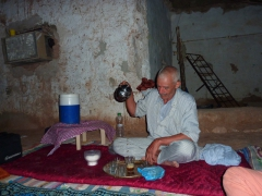 Yousef's father prepares tea after dinner; El Golea