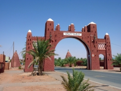Entranceway to Timimoun, legendary oasis town of the Sahara with an alluring mud-red color