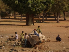 Kids playing on a tree trunk to while away the time