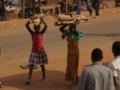 Young girls carrying a load of wood; Banfora