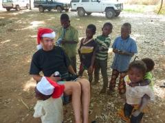 The Dutch Santa (Frans) entertains the village kids; Karfiguela campsite