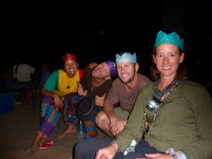 Wearing our Christmas cracker crowns (a British tradition); Karfiguela campsite