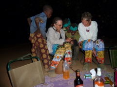 Norma entertaining the village kids with her IPOD touch; Karfiguela campsite