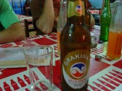 Drinking a Brakina Beer in Burkina Faso