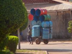 Transporting metal bins; Bobo-Dioulasso