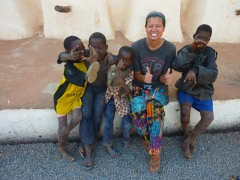 Becky and the local kids strike silly poses outside Bobo's Vieille Mosquee