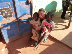 Becky poses next to two adorable Bobo kids