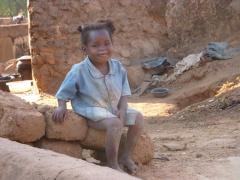 A pretty girl strikes a pose; old village of Kibidoue in Bobo