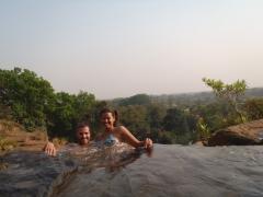 Posing in a natural infinity pool; Chutes de Karfiguela