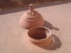 The clay cover is used only when it pours down rain to prevent flooding inside the mosque; Bobo's Vieille Mosquee
