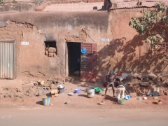Village kids playing outside their home; Bobo