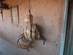 Gourd containers hanging outside a home in the old village of Kibidoue